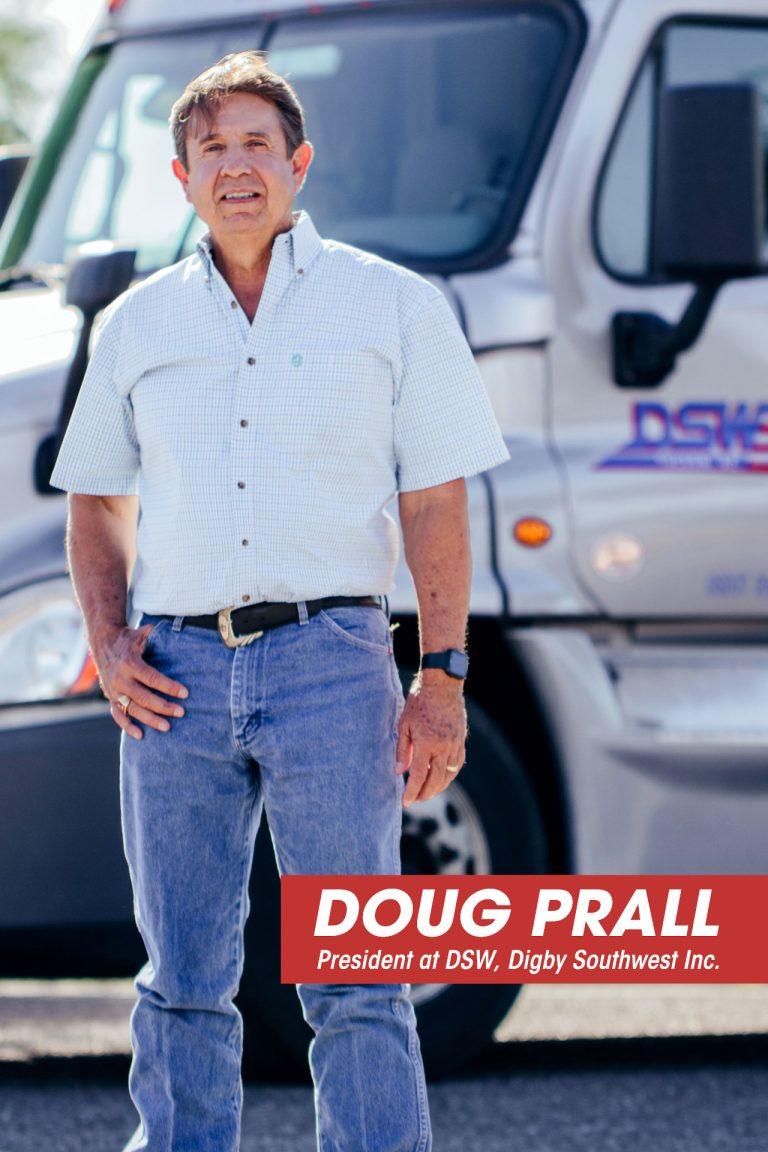 Doug Prall, president of our truck driving company, standing in front of a truck